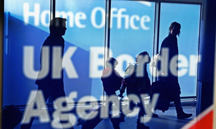 This is the first time net migration to the UK has been under 300,000 in two years (Jeff J Mitchell/Getty Images)