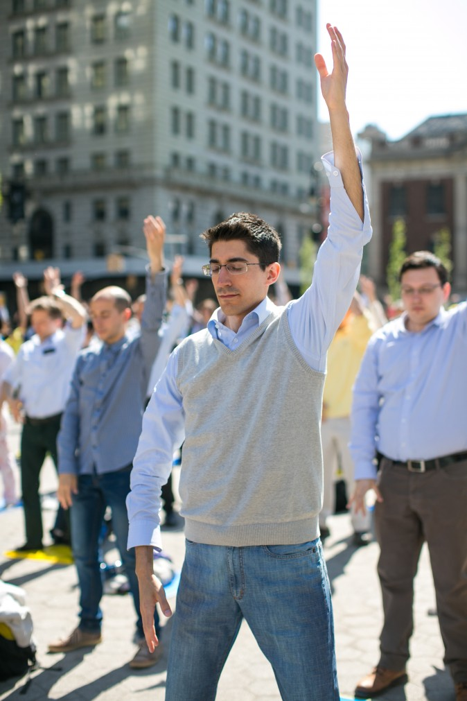People practice the Falun Gong meditation in New York. (Benjamin Chasteen/Epoch Times)