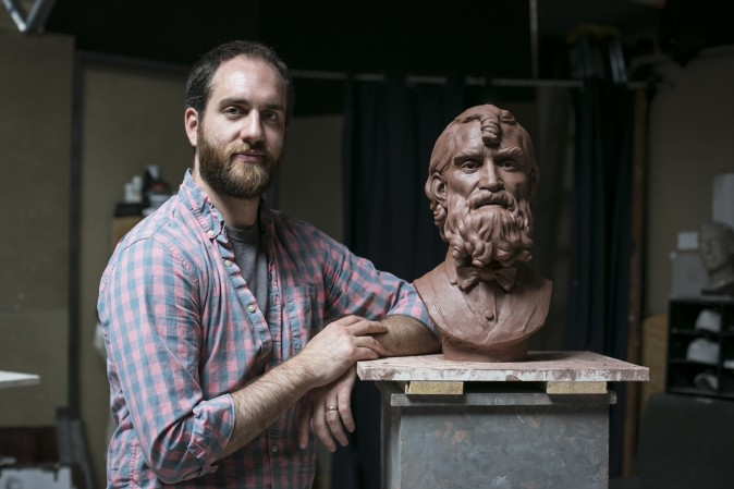 Artist Brendan Johnston next to his sculpture (in progress) at Grand Central Atelier, where he also teaches, in Long Island City, New York on March 25, 2016. (Samira Bouaou/Epoch Times)