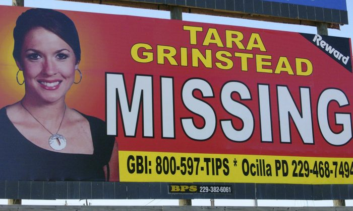 Missing teacher Tara Grinstead is prominently displayed on a billboard in Ocilla, Ga., on  Oct. 4, 2006. (AP Photo/Elliott Minor)