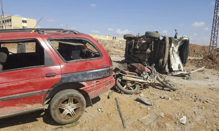 Damaged cars after a suicide attacker blew his small pick-up truck outside a security office in Sousian village, about 8 kilometers (5 miles) north of al-Bab on Feb. 24, 2017. (Thiqa News Agency, via AP)