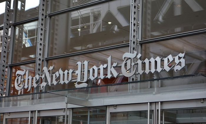 The sign over the west entrance of the New York Times building at 620 Eighth Ave.  in New York on April 28, 2016. (DON EMMERT/AFP/Getty Images)