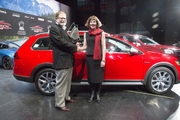 AJAC Director David Taylor, left, Maria Stenstrm, President and CEO, Volkswagen Canada Inc, right, after Volkswagen Golf Alltrack won the Canadian Car of the Year award in Toronto on February 16, 2017. (Photo By: Michelle Siu/AJAC)