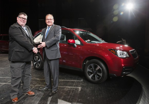 Gary Grant, AJAC Co-Chair (left) poses for a photo with  Ted Lalka, Vice President, Product Management, Marketing & Customer Experience for Subaru (right) after the Subaru Forester wins the Canadian Utility Vehicle of the Year award in Toronto on February 16, 2017. (Photo By: Michelle Siu/AJAC)