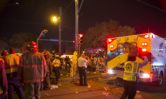 New Orleans police work at the scene where a vehicle plowed into a crowd watching the Krewe of Endymion parade in the Mid-City section of New Orleans on Feb. 25, 2017. (Chris Granger/NOLA.com The Times-Picayune via AP)