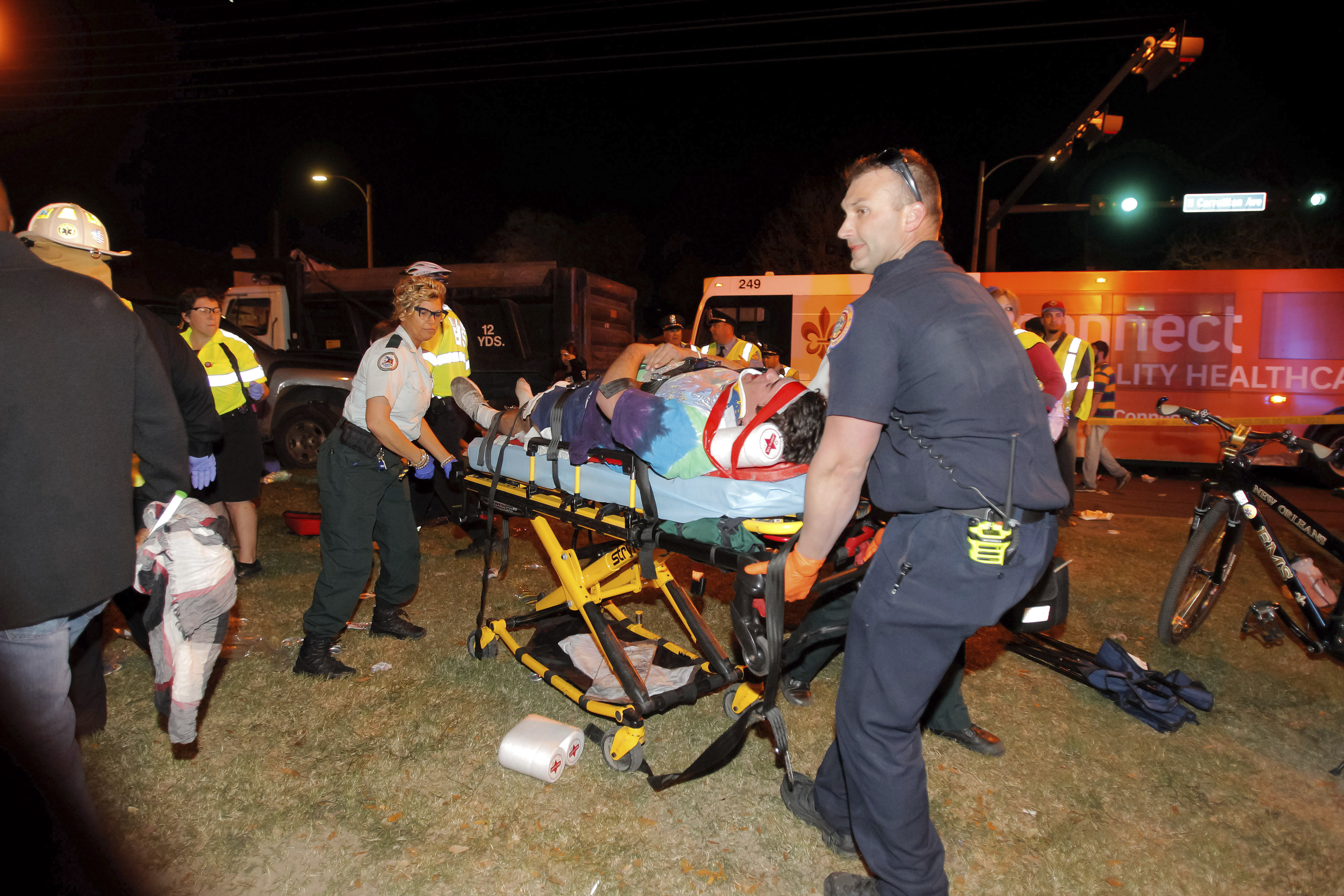 New Orleans emergency personnel attend to an injured parade watcher after a pickup truck plowed into a crowd injuring multiple people watching the Krewe of Endymion parade in the Mid-City section of New Orleans on Feb. 25, 2017. (Scott Threlkeld/The Advocate via AP)