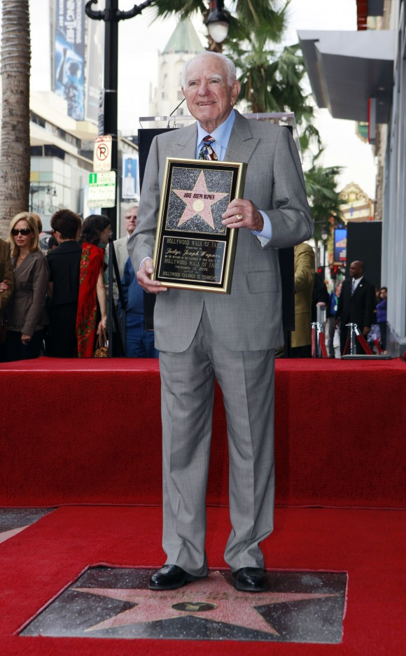 "Judge Joseph Wapner is honored with star on the Hollywood Walk of Fame in Los Angeles on Nov. 12, 2009. Wapner, who presided over ""The People's Court"" with steady force during the heyday of the reality courtroom show, has died. Wapner died at home in his sleep on Feb. 26, 2017, according to his son, David Wapner. (AP Photo/Damian Dovarganes)"