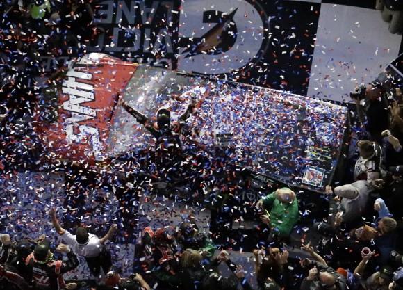 Kurt Busch, center, celebrates in Victory Lane after winning the Daytona 500 auto race at Daytona International Speedway on Feb. 26, 2017, in Daytona Beach, Fla. (AP Photo/John Raoux)