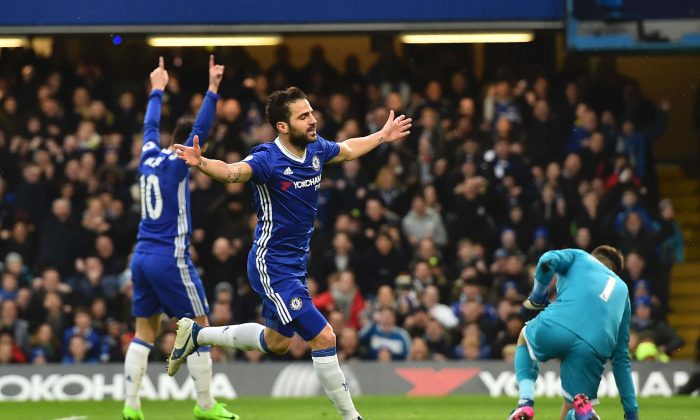 Chelsea's Spanish midfielder Cesc Fabregas (C) celebrates scoring the opening goal during the English Premier League football match between Chelsea and Swansea at Stamford Bridge in London on Feb 25, 2017. (Glyn Kirk/AFP/Getty Images)