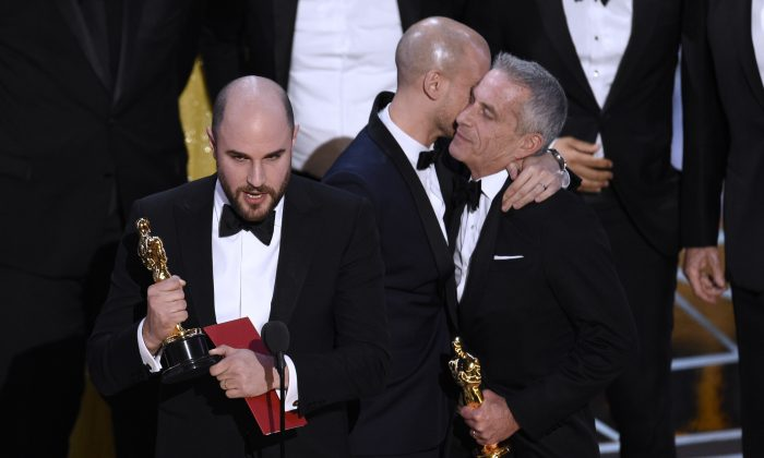 "Jordan Horowitz, left, of ""La La Land,"" mistakenly accepts the award for best picture at the Oscars on Sunday, Feb. 26, 2017, at the Dolby Theatre in Los Angeles. It was later determined that ""Moonlight,"" won best picture. (Chris Pizzello/Invision/AP)"