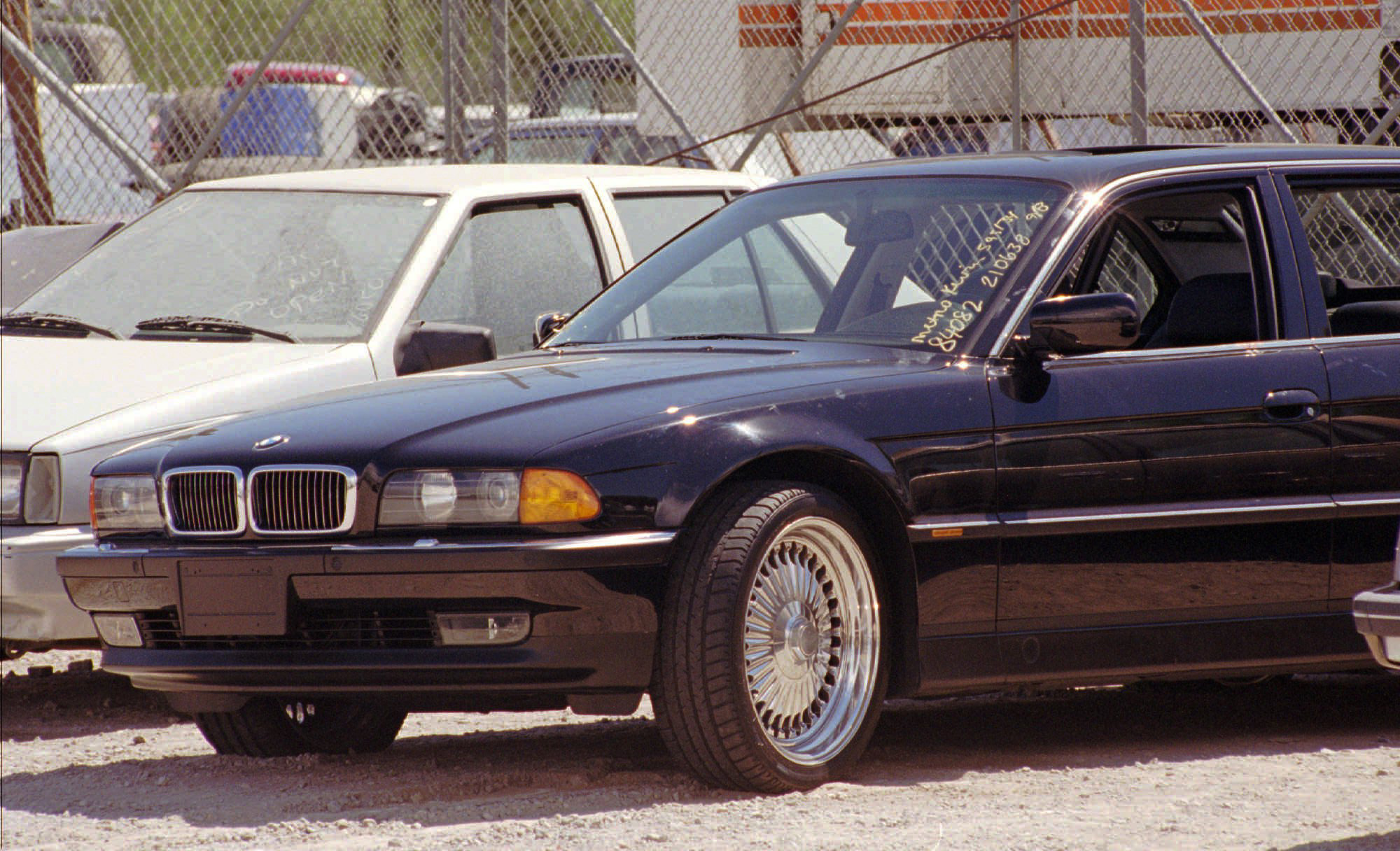 A black BMW, riddled with bullet holes, is seen in a Las Vegas police impound lot on Sept. 8, 1996. (AP Photo/Lennox McLendon, File)