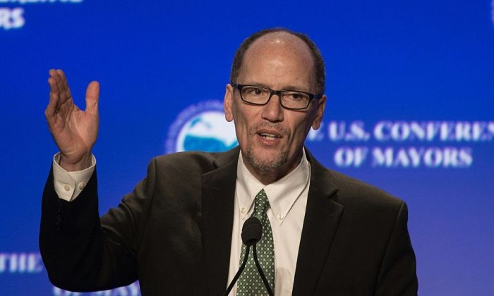 US Labor Secretary Tom Perez speaks at the 84th annual Winter Meeting of The United States Conference of Mayors in Washington, DC, on January 21, 2016. / AFP / Nicholas Kamm        (Photo credit should read NICHOLAS KAMM/AFP/Getty Images)