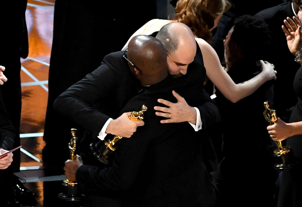 'La La Land' producer Jordan Horowitz (L) hands over the Best Picture award to 'Moonlight' writer/director Barry Jenkins following a presentation error onstage during the 89th Annual Academy Awards at Hollywood & Highland Center in Hollywood, CA., on February 26, 2017.  (Kevin Winter/Getty Images)