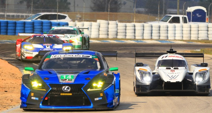 Multi-class racing—here, a pair of GTDs, a GTLM and a prototype—is the hallmark of sportscar endurance racing. Balancing each class, and all cars within each class, is tremendously difficult but also tremendously important. (Chris Jasurek/Epoch Times)