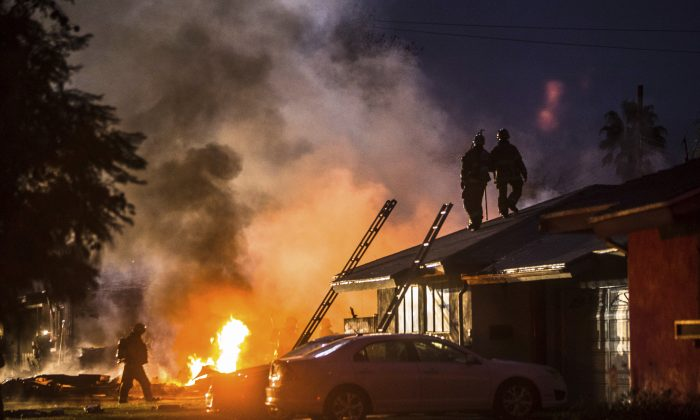 Smoke rises from a fire after a plane crashed in Riverside, CA., on Feb. 27, 2017. (Watchara Phomicinda/The Press-Enterprise via AP)