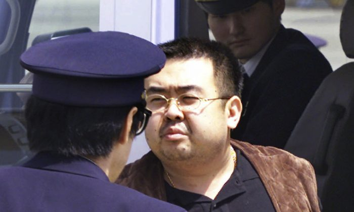 Kim Jong Nam, exiled half brother of North Korea's leader Kim Jong Un, escorted by Japanese police officers at the airport in Narita, Japan on May 4, 2001. (AP Photo/Itsuo Inouye)