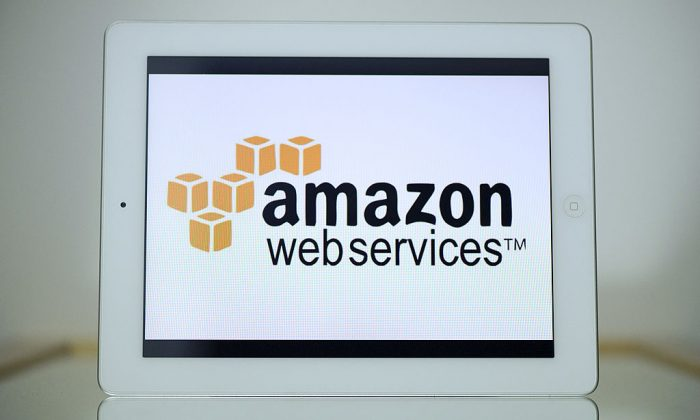 "A picture shows an Ipad with the logo of ""Amazon web services"" on November 13, 2012 in Paris. (LIONEL BONAVENTURE/AFP/Getty Images)"