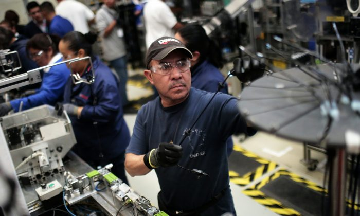 Workers at the auto parts production line in the Bosch factory in San Luis Potosi, Mexico, on Jan. 11. (PARDO/AFP/Getty Images)