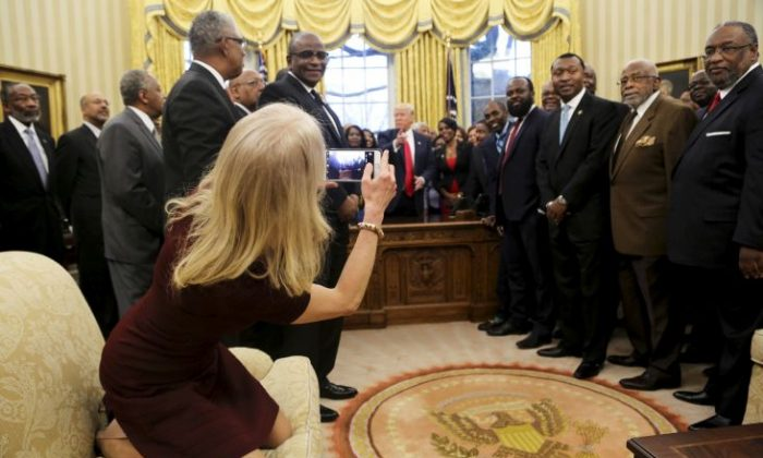 Counselor to the President Kellyanne Conway takes a picture of U.S. President Donald Trump with members of the Historically Black Colleges and Universities in the Oval Office of the White House, on February 27, 2017 in Washington, DC. (Aude Guerrucci-Pool/Getty Images)