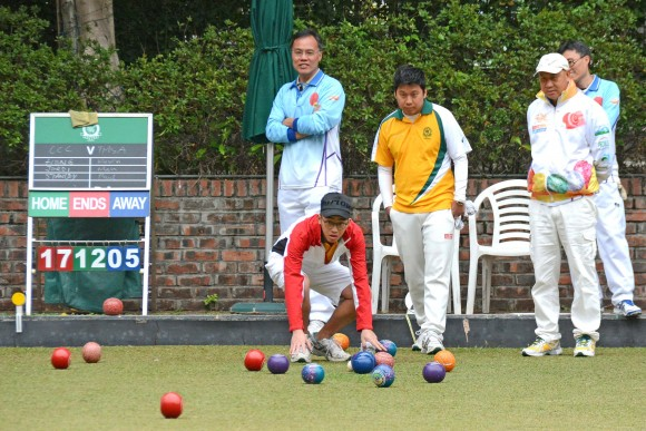 Craigengower Cricket Club's Jordi Lo (in red jacket), anxiously watches his skipper's bowl entering the head. The CCC team hung on to win the match 8:0 and successfully defended their Triples League title. (Stephanie Worth)