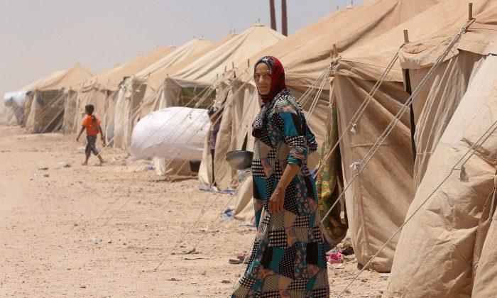 A camp for internally displaced civilians outside Fallujah, Iraq, on June 14, 2016.  (AP Photo/Hadi Mizban)