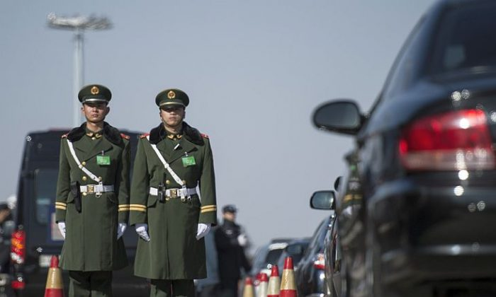 Paramilitary police officers stand guard during the opening session of the Chinese People's Political Consultative Conference (CPPCC) at the Great Hall of the People in Beijing on March 3, 2015. Thousands of delegates from across China and the Chinese leadership will gather for its annual legislature meetings from March 3 in Beijing. (FRED DUFOUR/AFP/Getty Images)