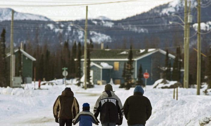 Residents walk in the northern Labrador community of Natuashish, N.L., in this file photo. (The Canadian Press/Andrew Vaughan)