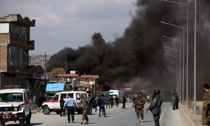 Smoke rises from a district police headquarters after a suicide bombing in Kabul, Afghanistan on March 1, 2017. (AP Photo/ Rahmat Gul)