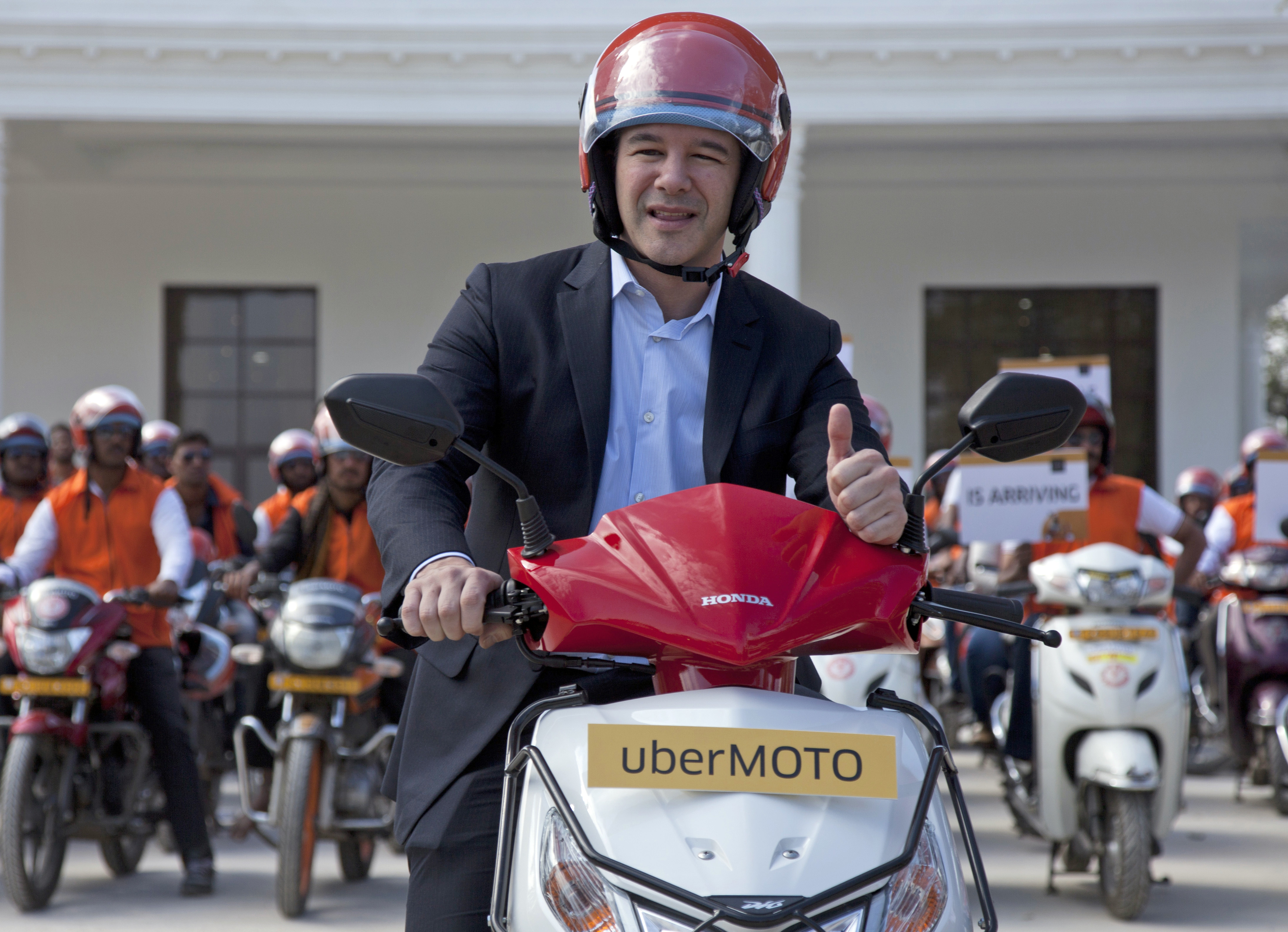 Uber CEO Travis Kalanick, during the launch of its bike-sharing product, uberMOTO, in Hyderabad, India on Dec. 13, 2016. (AP Photo/Mahesh Kumar A., File)