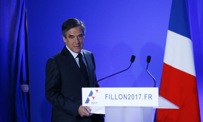 Conservative presidential candidate Francois Fillon delivers his speech at his campaign headquarters in Paris on March 1, 2017. (AP Photo/Francois Mori)