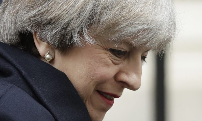 British Prime Minister, Theresa May, leaves 10 Downing Street in London, to attend Prime Minister's Questions at the Houses of Parliament on March 1, 2017. (AP Photo/Matt Dunham)