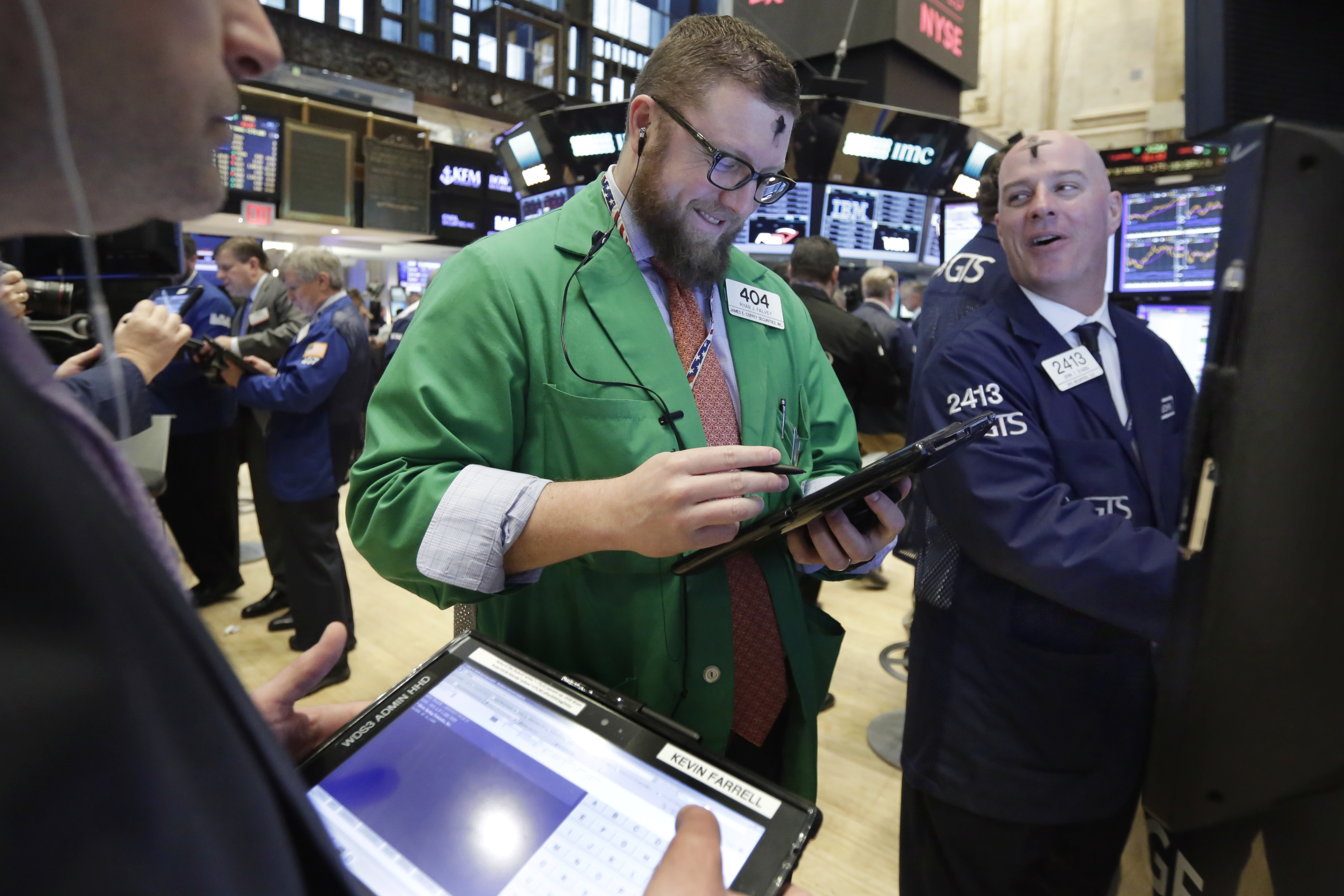 Trader Ryan Falvey, center, and specialist John O'Hara work on the floor of the New York Stock Exchange, Wednesday, March 1, 2017. Stocks opened strongly higher on Wall Street, led by big gains in banks as investors expected interest rates to rise. The early jump Wednesday put the Dow Jones industrial average above 21,000 points for the first time. (AP Photo/Richard Drew)