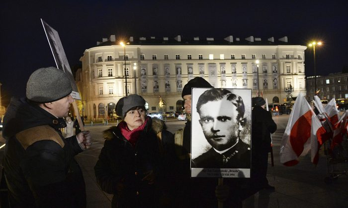 Warsaw residents attend state ceremonies in honor of clandestine anti-communist fighters of the post-World War II era in Pilsudski Square in Warsaw, Poland on March 1, 2017. (AP Photo/Czarek Sokolowski)