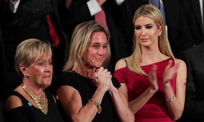 Widow of Fallen Navy Seal, Senior Chief William Owens, Carryn Owens and Ivanka Trump attend a joint session of the U.S. Congress with U.S. President Donald Trump in the House chamber of  the U.S. Capitol in Washington on Feb. 28, 2017. (Alex Wong/Getty Images)