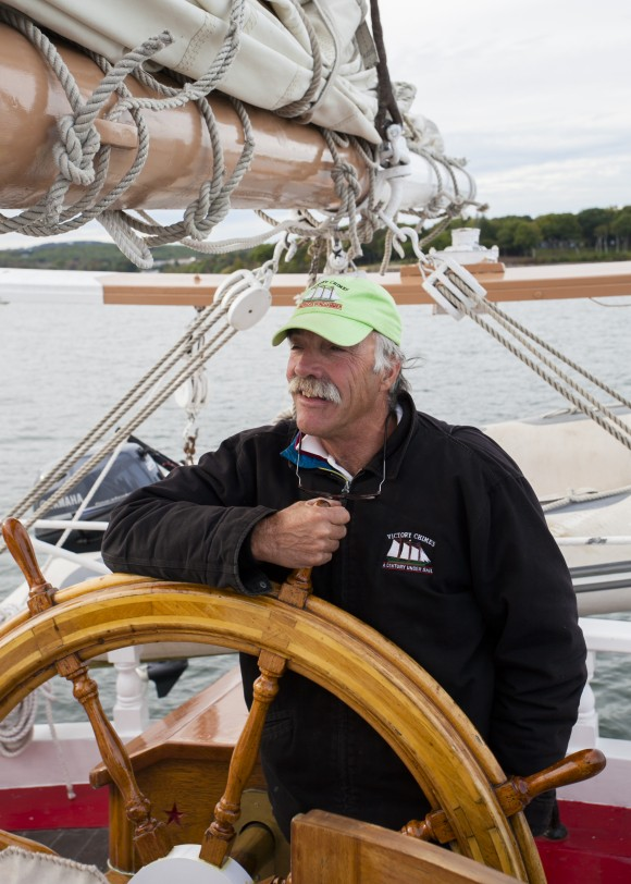 Captain Kip Files at the helm of the Victory Chimes. (Channaly Philipp/Epoch Times)