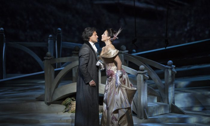 """Tenor Vittorio Grigolo as Werther and mezzo-soprano Veronica Simeoni as Charlotte in Jules Massenet's """"Werther,"""" about a poet whom we would likely now call manic-depressive. (Marty Sohl/Metropolitan Opera)"""