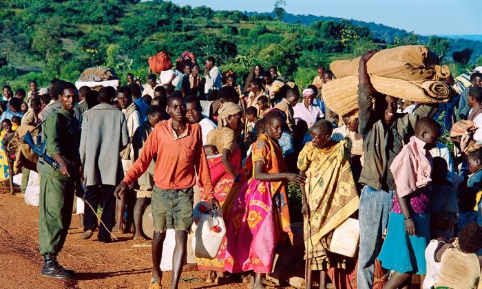 Refugees from Rwanda who have been forced to flee their homes by 12 days of ethnic carbage, are checked on April 19, 1994 at Gasenyi border, about 230kms (144 miles) northwest of Bujumbura, before being sent to a refugee camp. (PASCAL GUYOT/AFP/Getty Images)