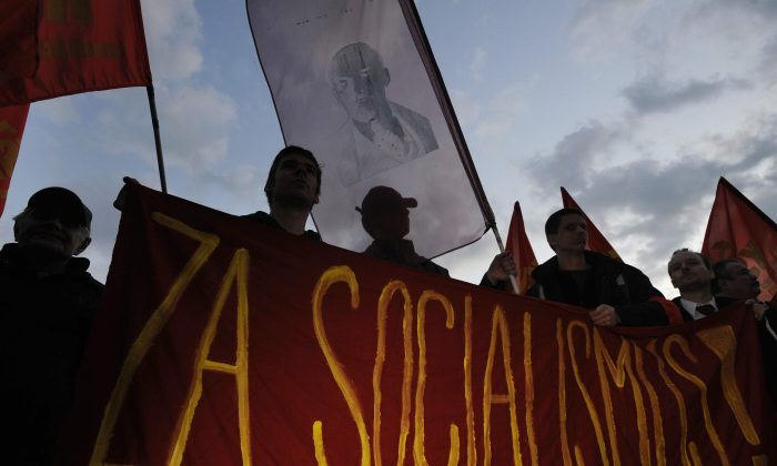 Pro-communist supporters hold flags and a portrait of Vladimir Lenin as they protest against the government in central Prague, Czech, in this file photo. (MICHAL CIZEK/AFP/Getty Images)