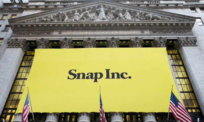 A banner for Snap Inc. hangs from the front of the New York Stock Exchange in New York on March 2, 2017. (AP Photo/Mark Lennihan)