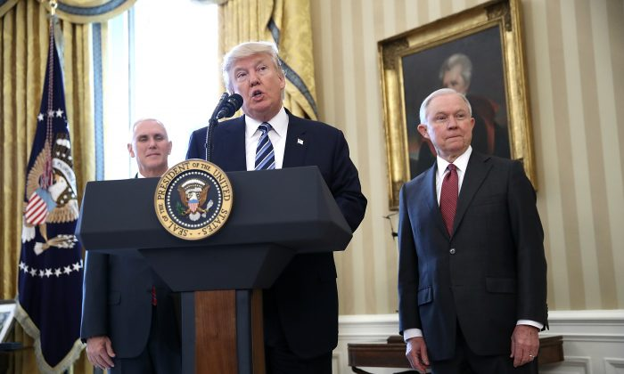 President Donald Trump (C) delivers remarks before the swearing in ceremony for Sen. Jeff Sessions (R) in the Oval Office of the White House in Washington, DC on Feb. 9, 2017. (Win McNamee/Getty Images)