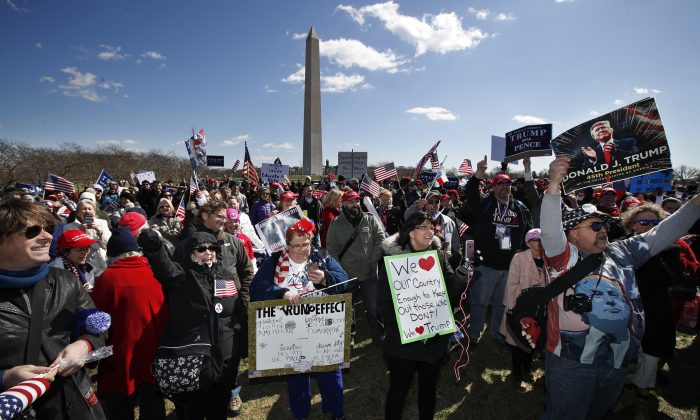 Supporters of President Donald Trump, cheer at the National Mall near the Washington Monument in Washington during a rally organized by the North Carolina-based group Gays for Trump on March 4, 2017. (AP Photo/Manuel Balce Ceneta)