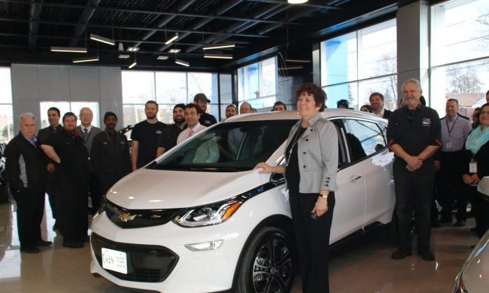 Samantha Mesrobian and her 2017 Chevrolet Bolt EV Premier and dealership personnel. (Courtesy of David Taylor)