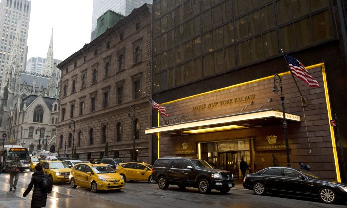 Traffic passes St. Patrick's Cathedral (L) and the Lotte New York Palace Hotel, in New York on March 1, 2017. The hotel occupies land the New York Archdiocese is seeking to mortgage to raise $100 million for clergy sexual abuse settlements. (AP Photo/Mark Lennihan, File)