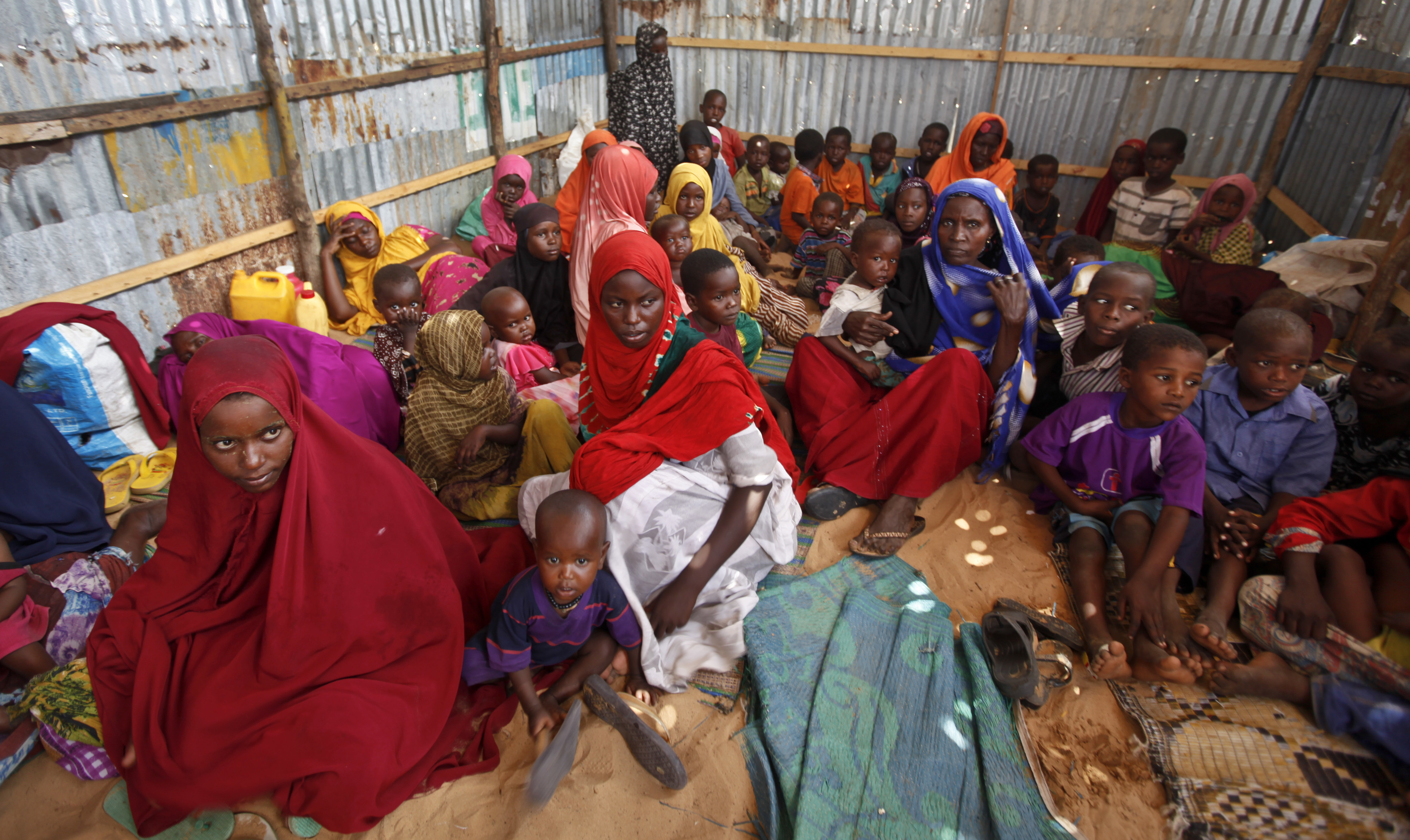 Displaced Somalis who fled the drought in southern Somalia sit in a camp in the capital Mogadishu, Somalia, in this file photo. (AP Photo/Farah Abdi Warsameh, File)