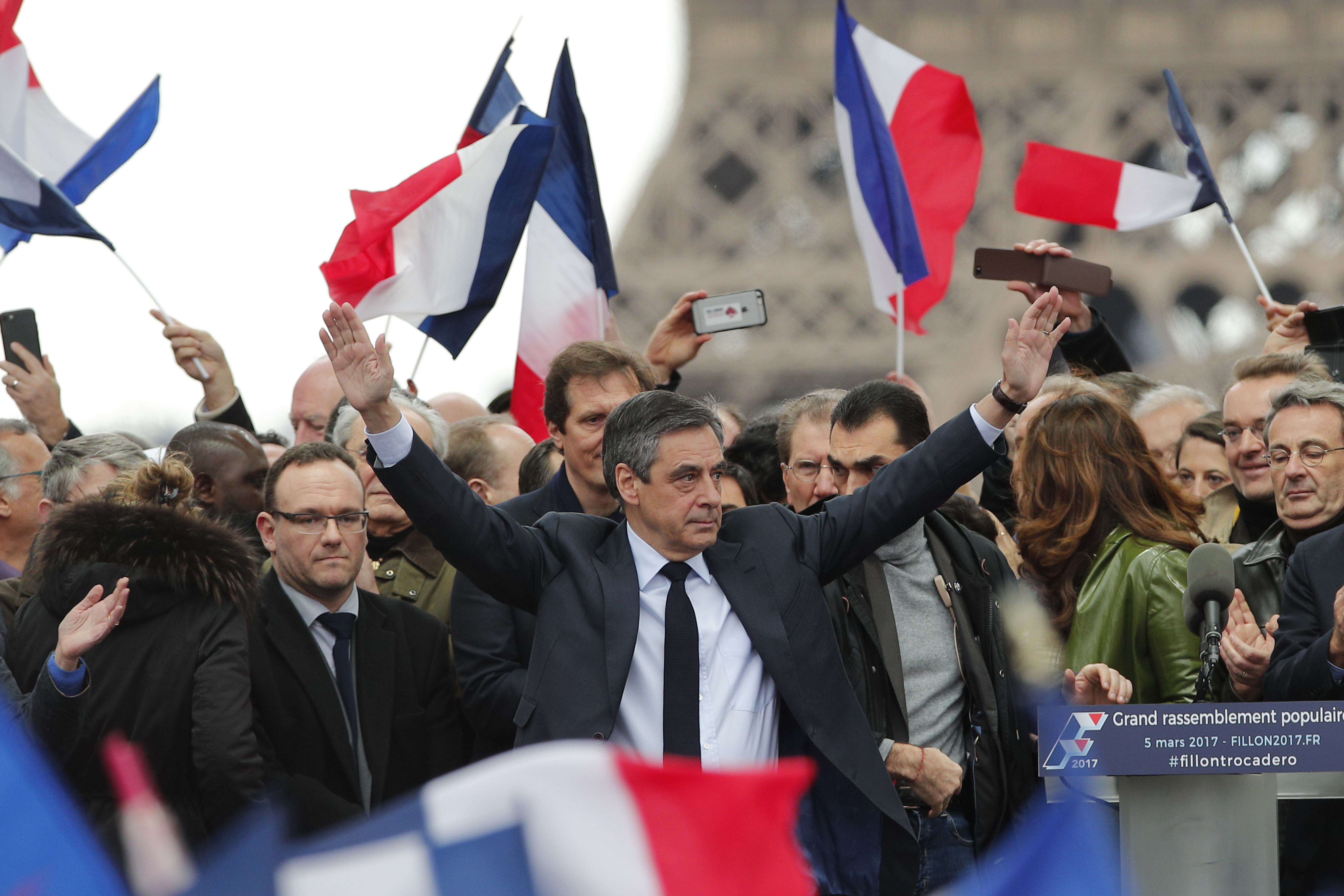 French conservative presidential candidate Francois Fillon cheers the crowd after delivering his speech during a rally in Paris on March 5, 2017. (AP Photo/Christophe Ena)
