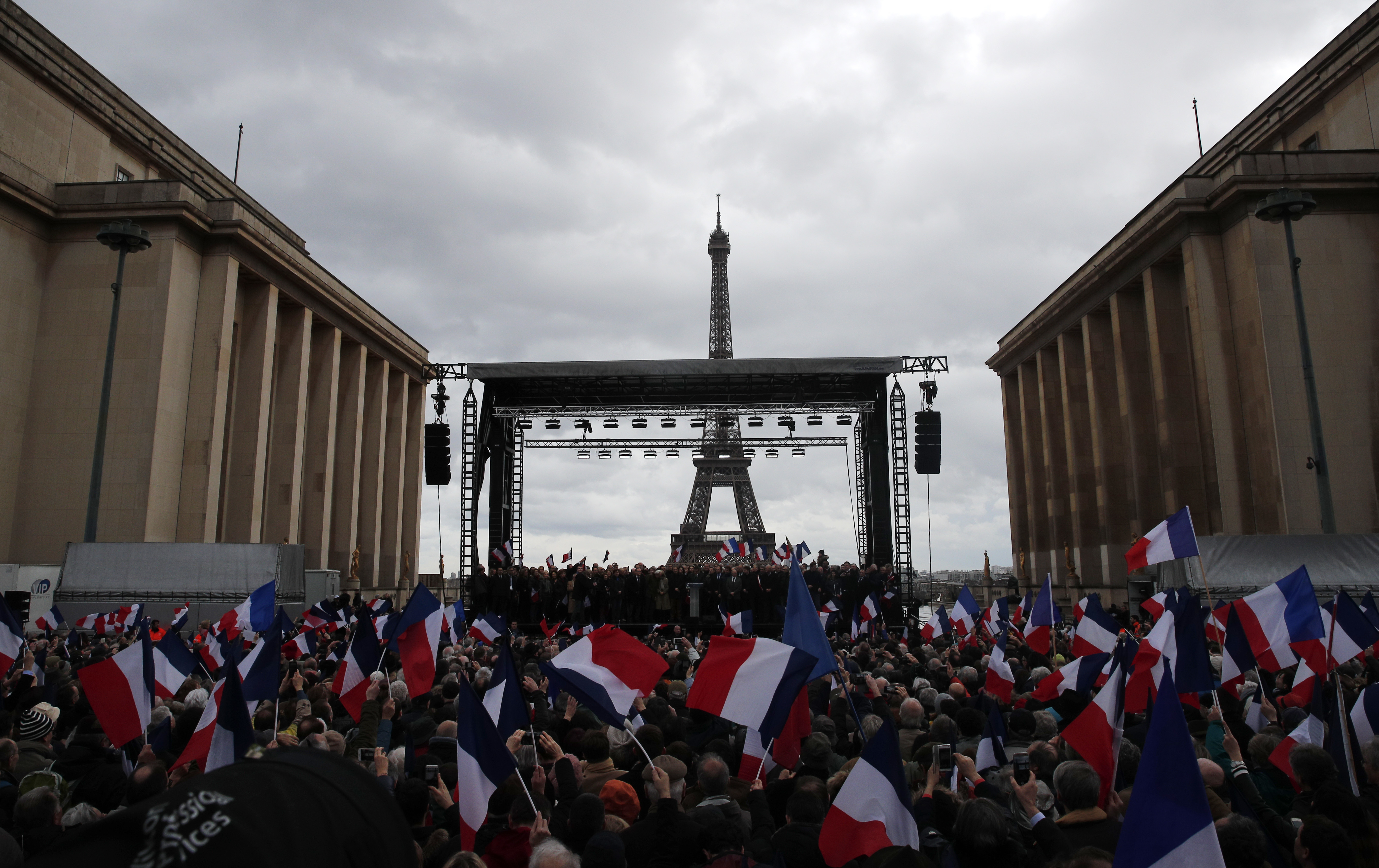 Supporters listen to French conservative presidential candidate Francois Fillon delivering his speech during a rally in Paris on March 5, 2017. (AP Photo/Christophe Ena)
