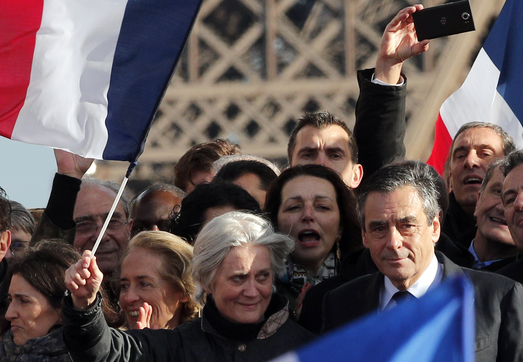 French conservative presidential candidate Francois Fillon and his wife Penelope appear during a rally in Paris on March 5, 2017. (AP Photo/Christophe Ena)