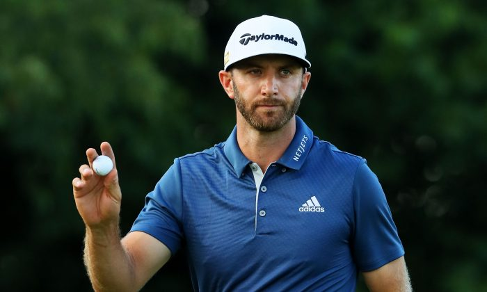 Dustin Johnson celebrates a par save on the 16th green during the final round of the U.S. Open at Oakmont Country Club on June 19 in Oakmont, Pennsylvania. The discussion about rules at the tournament spurred changes in the rules of the game. (Andrew Redington/Getty Images)