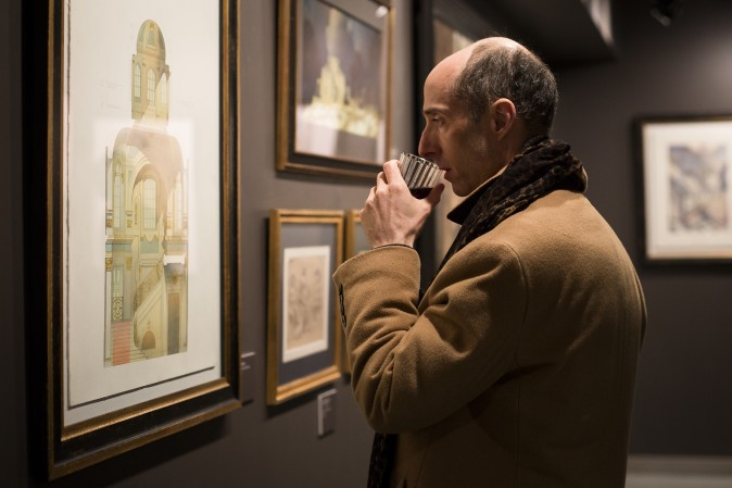 "A man looks at a drawing by Irina Shumitskaya at the ""Art of Architecture"" exhibit at Eleventh Street Arts gallery in Queens, New York, on March 2, 2017. (Samira Bouaou/Epoch Times)"