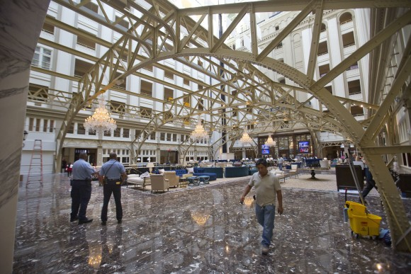 The main lobby of the Trump International Hotel in downtown Washington on Sept. 12, 2016. Trump's $200 million hotel inside the federally owned Old Post Office building has become the place to see, be seen, drink, network, even live, for the still-emerging Trump set. (AP Photo/Pablo Martinez Monsivais, File)